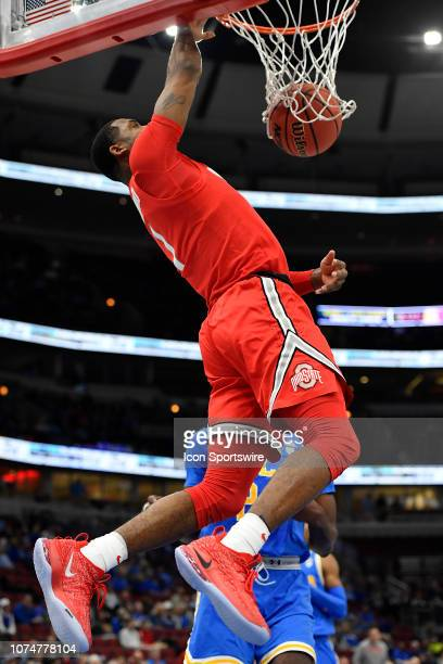 Ohio State Buckeyes guard Luther Muhammad goes up to dunk in front of UCLA Bruins guard Jalen Hill during the CBS Sports Classic on December 22 2018...