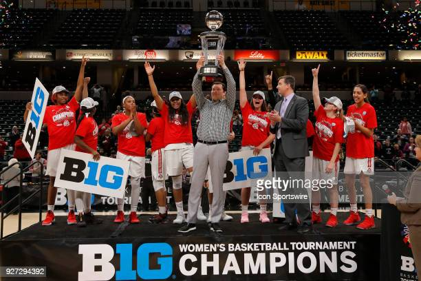 Ohio State Buckeyes Head Coach Kenin McGuff holds up the Big Ten Championship trophy after defeating the Maryland Terrapins during the Big Ten...