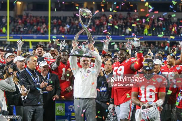 Ohio State Buckeyes head coach Urban Meyer lifts the trophy after winning the Goodyear Cotton Bowl Classic between Ohio State and USC on December 29...