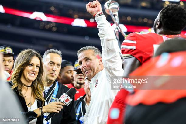 Ohio State Buckeyes head coach Urban Meyer raises his arm after accepting the trophy after the Goodyear Cotton Bowl between the USC Trojans and the...