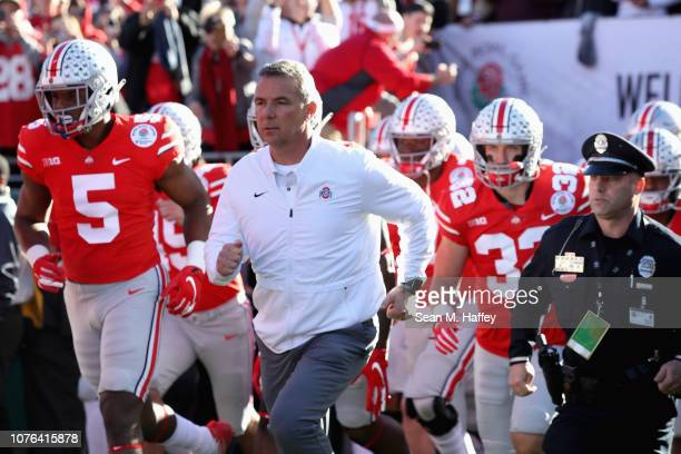 Ohio State Buckeyes head coach Urban Meyer runs on to the field during the Rose Bowl Game presented by Northwestern Mutual at the Rose Bowl on...