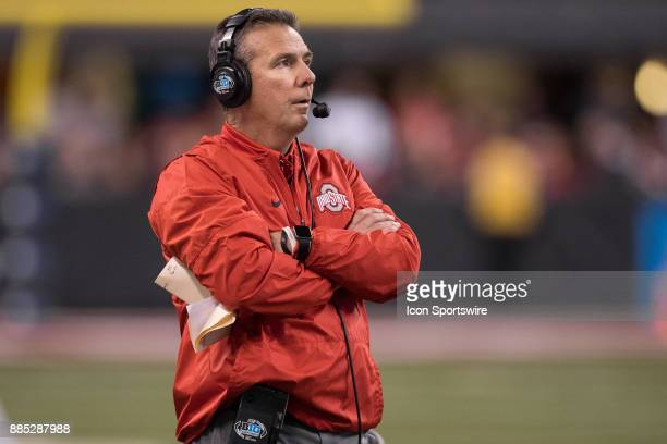 Ohio State Buckeyes head coach Urban Meyer watches a replay on the video board during the Big 10 Championship game between the Wisconsin Badgers and...