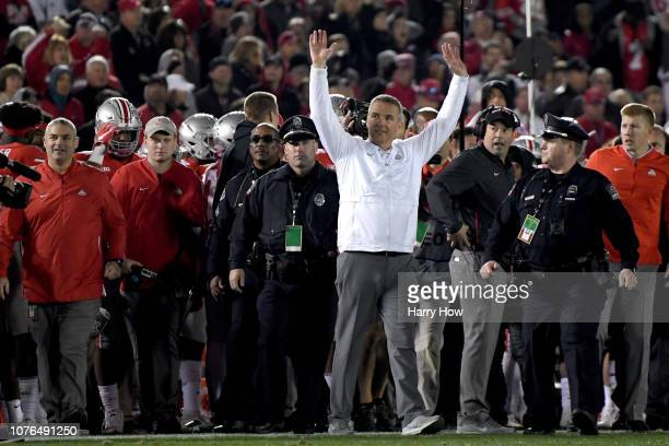 Ohio State Buckeyes head coach Urban Meyer waves to the crowd after the Ohio State Buckeyes win the Rose Bowl Game presented by Northwestern Mutual...