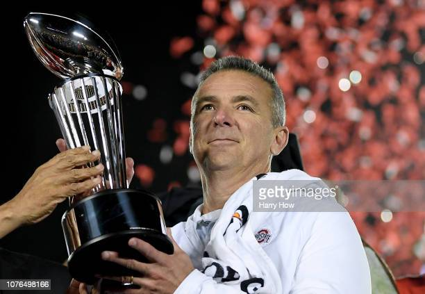 Ohio State Buckeyes head coach Urban Meyer with the Rose Bowl trophy celebrates winning the Rose Bowl Game presented by Northwestern Mutual at the...