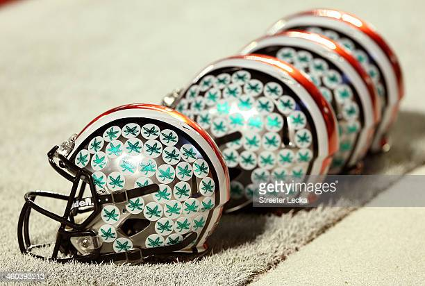 Ohio State Buckeyes helmets sit in the endzone prior to the Discover Orange Bowl against the Clemson Tigers at Sun Life Stadium on January 3 2014 in...
