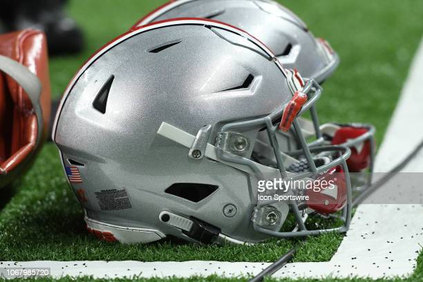 Ohio State Buckeyes helmets sit on the sidelines during the Big Ten Conference Championship college football game between the Northwestern Wildcats...