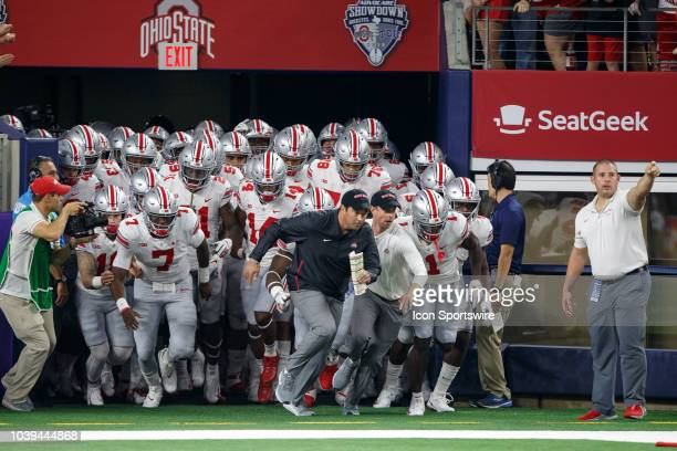 Ohio State Buckeyes interim head coach Ryan Day leads the team out of the tunnel during the Advocare Classic college football game between the Ohio...
