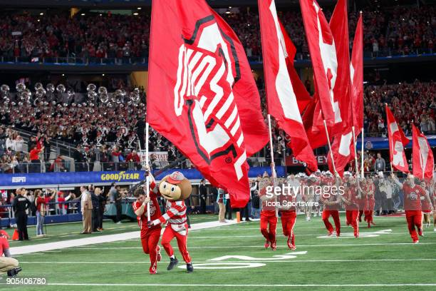 Ohio State Buckeyes mascot Brutus and the Ohio State cheerleaders lead the team out of the tunnel during the Cotton Bowl Classic matchup between the...