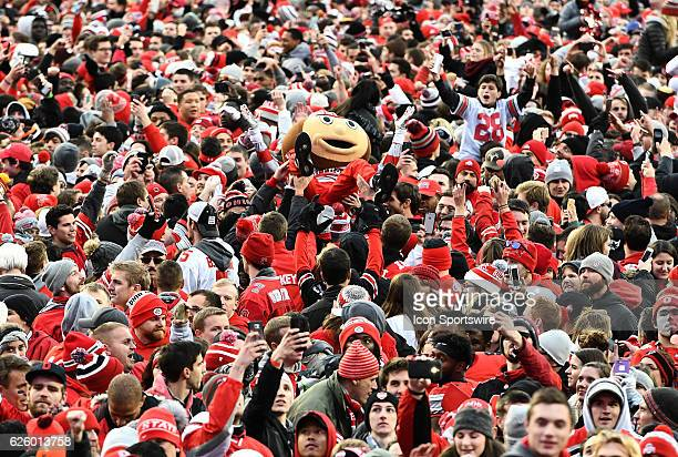 Ohio State Buckeyes mascot Brutus Buckeye crowd surfs in a sea of happy Buckeye fans following their 3027 double overtime win over the Michigan...