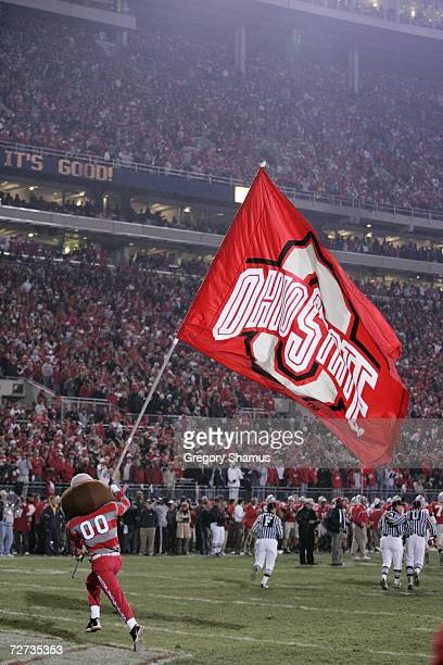 Ohio State Buckeyes mascot Brutus Buckeye waves a giant flag during the game against the Michigan Wolverines on November 18 2006 at Ohio Stadium in...