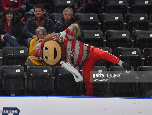 Ohio State Buckeyes mascot Brutus Buckeye wipes the glass during the team's NCAA Division I Men's Ice Hockey West Regional Championship Semifinal...