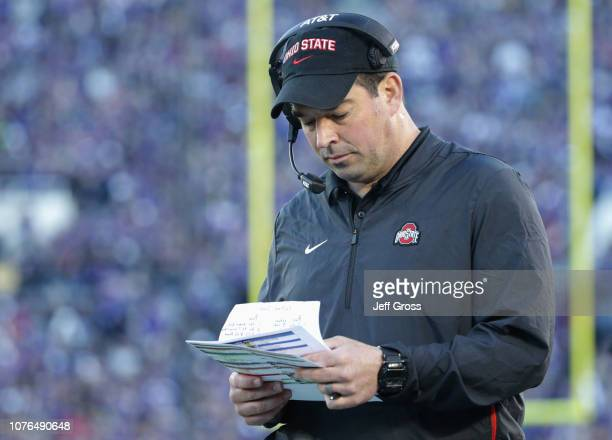 Ohio State Buckeyes offensive coordinator Ryan Day looks at notes during the Rose Bowl Game presented by Northwestern Mutual at the Rose Bowl on...