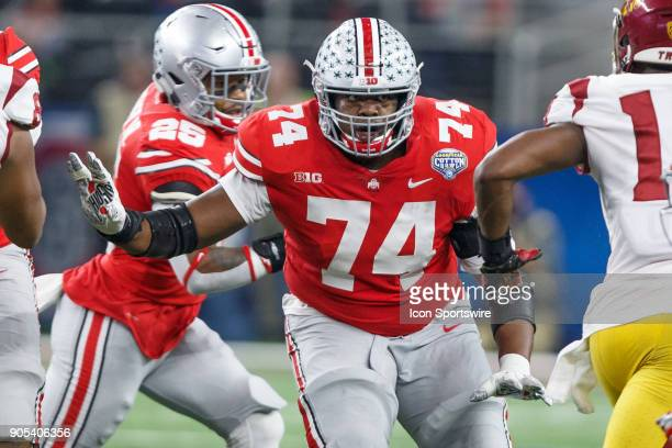 Ohio State Buckeyes offensive tackle Jamarco Jones blocks as running back Mike Weber runs the ball during the Cotton Bowl Classic matchup between the...