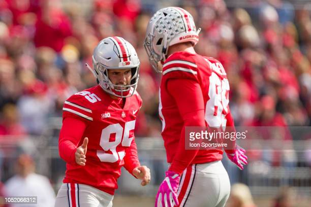 Ohio State Buckeyes place kicker Blake Haubeil celebrates with Ohio State Buckeyes tight end Luke Farrell after making a 47 yard field goal in a game...