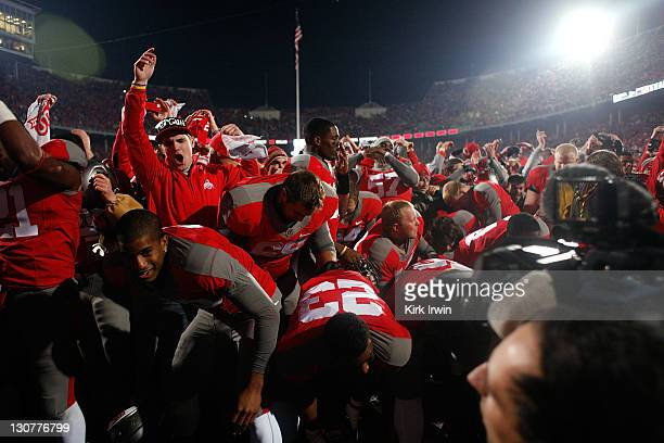 Ohio State Buckeyes players and fans celebrate after defeating the Wisconsin Badgers 3329 on October 29 2011 at Ohio Stadium in Columbus Ohio