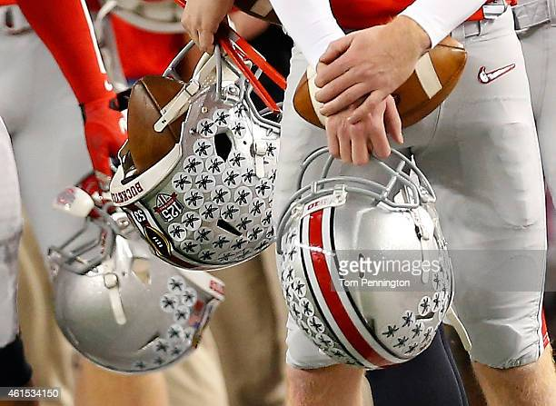 Ohio State Buckeyes players hold their helmets on the sideline during the College Football Playoff National Championship Game at ATT Stadium on...
