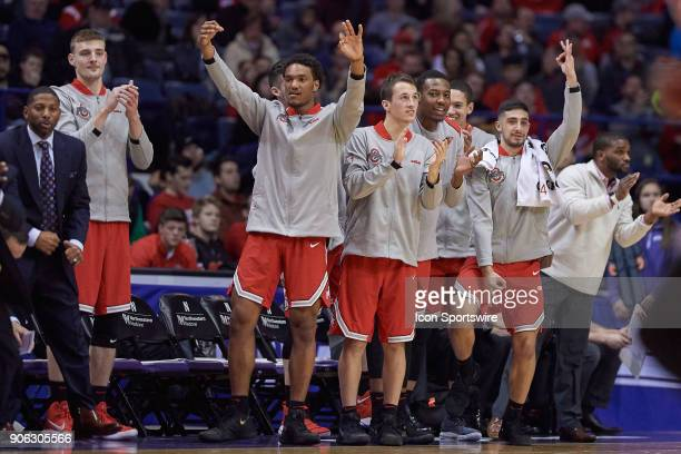 Ohio State Buckeyes players react from the bench after a play during the BIG Ten college basketball game between the Northwestern Wildcats and the...