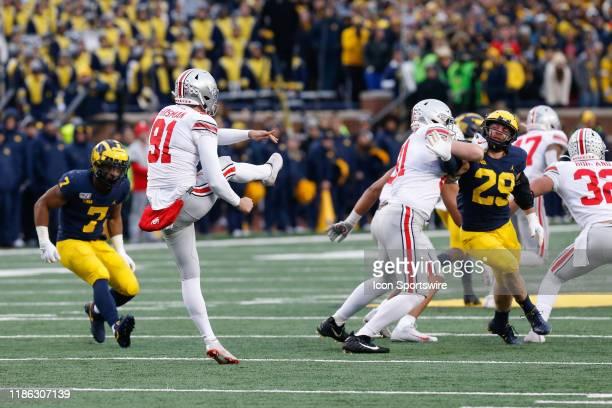 Ohio State Buckeyes punter Drue Chrisman punts during a regular season Big 10 Conference game between the Ohio State Buckeyes and the Michigan...