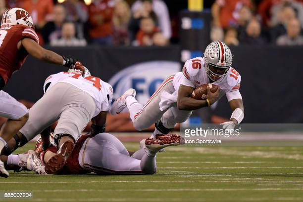 Ohio State Buckeyes quarterback JT Barrett goes airborne as he tries to get extra yards during the Big Ten Championship Game between the Ohio State...