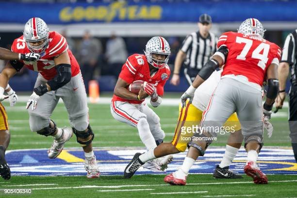 Ohio State Buckeyes quarterback JT Barrett looks for room to run during the Cotton Bowl Classic matchup between the USC Trojans and Ohio State...
