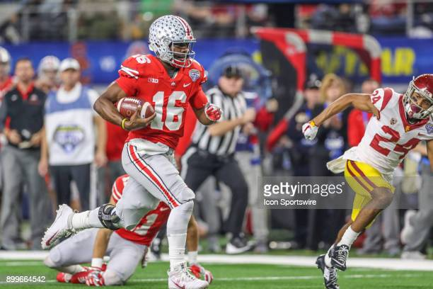 Ohio State Buckeyes quarterback JT Barrett runs to the end zone for a touchdown during the Goodyear Cotton Bowl Classic between Ohio State and USC on...