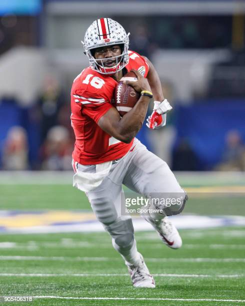 Ohio State Buckeyes quarterback JT Barrett runs up field during the Cotton Bowl Classic matchup between the USC Trojans and Ohio State Buckeyes on...