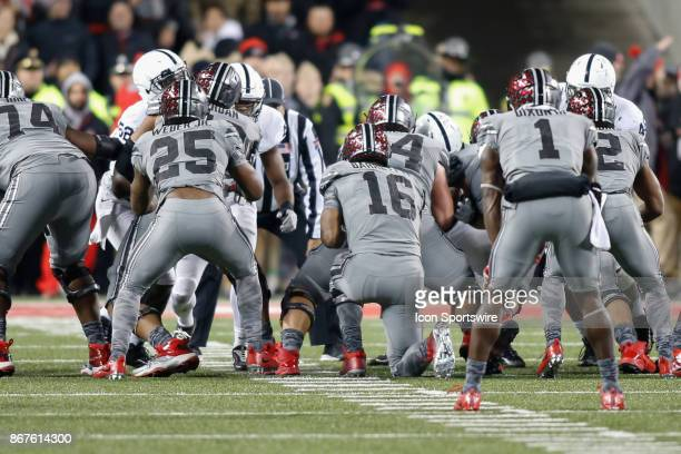 Ohio State Buckeyes quarterback JT Barrett takes knee to run the clock out on the final play during the second half of game action between the Penn...