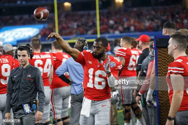 Ohio State Buckeyes quarterback JT Barrett warms up on the sideline during the Cotton Bowl Classic matchup between the USC Trojans and Ohio State...