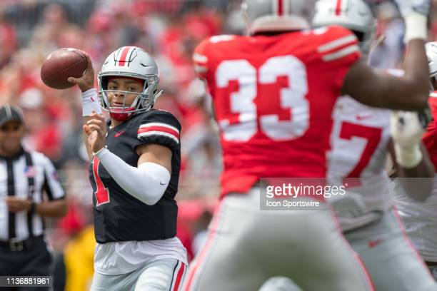 Ohio State Buckeyes quarterback Justin Fields passes the ball during the Ohio State Life Sports Spring Game presented by Nationwide at Ohio Stadium...