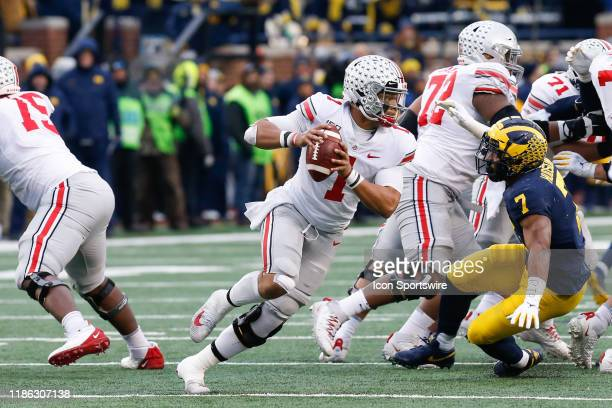 Ohio State Buckeyes quarterback Justin Fields rolls out looking for a receiver during a regular season Big 10 Conference game between the Ohio State...