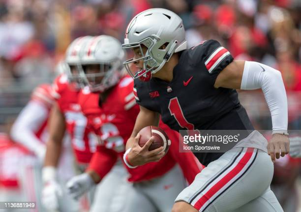 Ohio State Buckeyes quarterback Justin Fields scrambles with the ball during the Ohio State Life Sports Spring Game presented by Nationwide at Ohio...