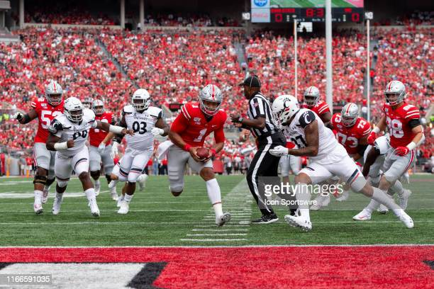 Ohio State Buckeyes quarterback Justin Fields sprints for a touchdown during game action between the Ohio State Buckeyes and the Cincinnati Bearcats...