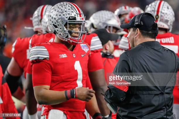 Ohio State Buckeyes quarterback Justin Fields talks with Ohio State Buckeyes head coach Ryan Day during the Fiesta Bowl college football playoff semi...