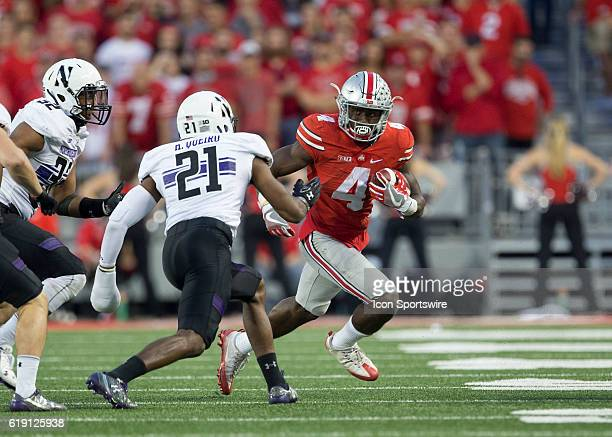 Ohio State Buckeyes running back Curtis Samuel attempts to get around Northwestern Wildcats safety Kyle Queiro during an NCAA football game between...