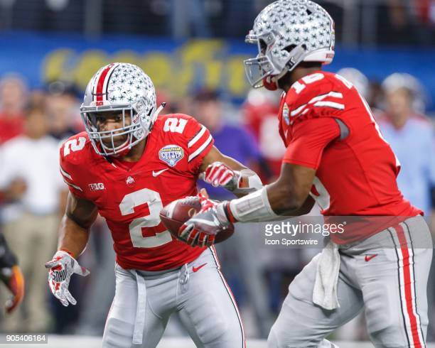 Ohio State Buckeyes running back JK Dobbins prepares to take the handoff from quarterback JT Barrett during the Cotton Bowl Classic matchup between...