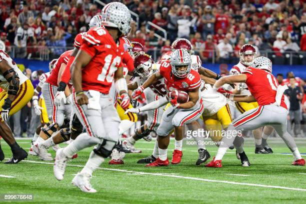 Ohio State Buckeyes running back JK Dobbins tries to spin out of the defense in the line of scrimmage during the Goodyear Cotton Bowl between the USC...