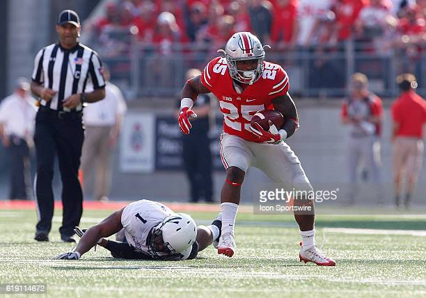 Ohio State Buckeyes running back Mike Weber escapes a tackle attempt by Northwestern Wildcats linebacker Anthony Walker Jr. During an NCAA football...