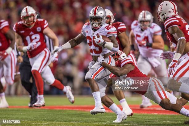 Ohio State Buckeyes running back Mike Weber is tackled by Nebraska Cornhuskers defensive back Joshua Kalu on October 14 2017 at Memorial Stadium in...