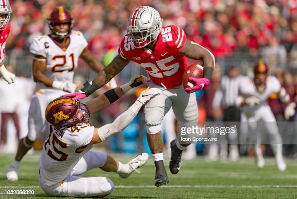 Ohio State Buckeyes running back Mike Weber stiff arms Minnesota Golden Gophers linebacker Carter Coughlin in a game between the Ohio State Buckeyes...
