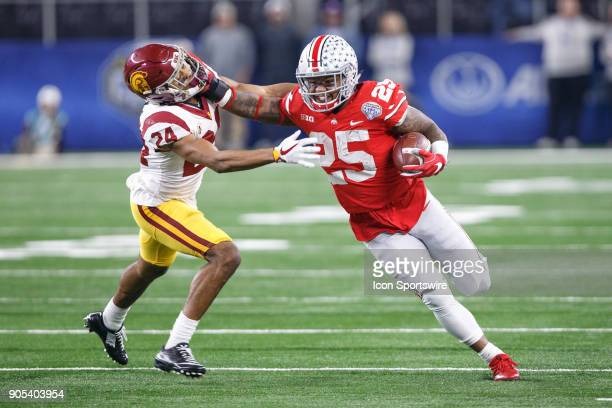 Ohio State Buckeyes running back Mike Weber stiff arms USC Trojans cornerback Isaiah Langley during the Cotton Bowl Classic matchup between the USC...