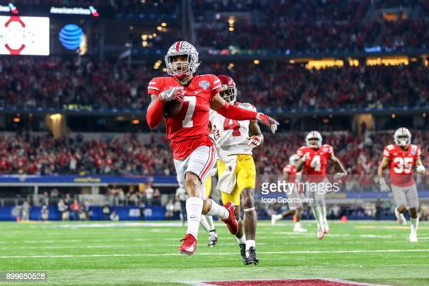 Ohio State Buckeyes safety Damon Webb intercepts the football and returns it for a touchdown during the ATT Cotton Bowl between the USC Trojans and...