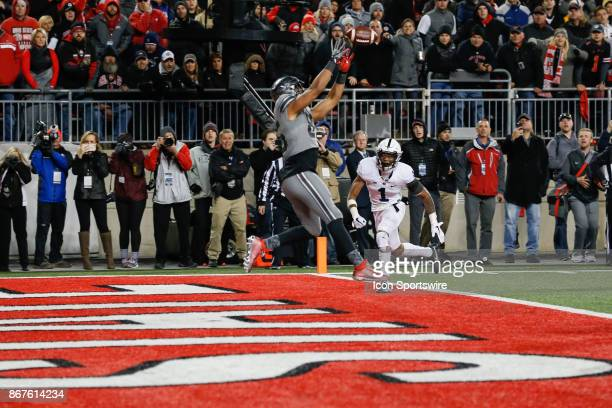 Ohio State Buckeyes tight end Marcus Baugh catches a pass in the end zone for a touchdown during the second half of game action between the Penn...