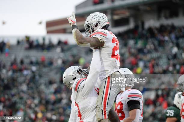 Ohio State Buckeyes tight end Rashod Berry raises running back Mike Weber toward the sky after sealing the game with a 4th quarter touchdown run...