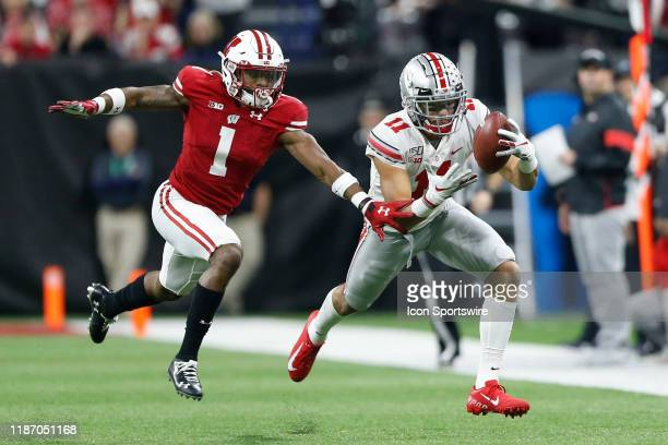 Ohio State Buckeyes wide receiver Austin Mack hauls in the pass while being defended by Wisconsin Badgers corner back Faion Hicks during the Big 10...