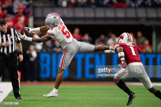 Ohio State Buckeyes wide receiver Garrett Wilson catches a pass by the sidelines during the Big 10 Championship game between the Wisconsin Badgers...