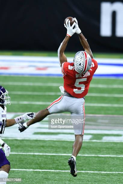 Ohio State Buckeyes wide receiver Garrett Wilson leaps to make a catch during the Big Ten Conference Championship football game between the...