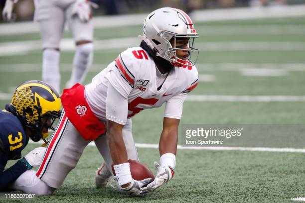 Ohio State Buckeyes wide receiver Garrett Wilson looks to the sideline after a play during a regular season Big 10 Conference game between the Ohio...