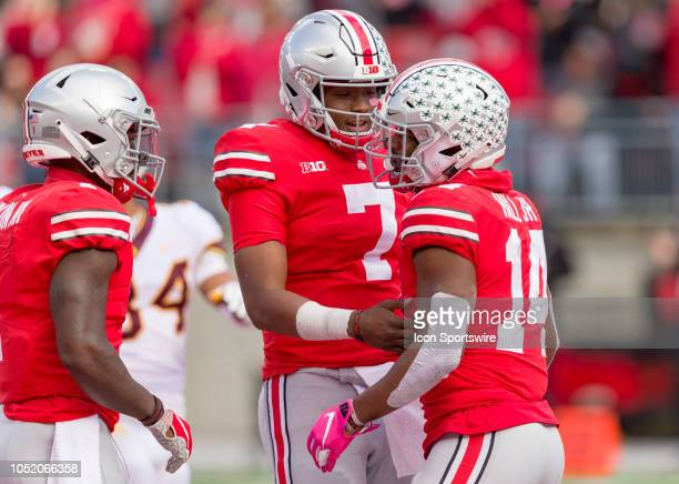 Ohio State Buckeyes wide receiver KJ Hill celebrates with Ohio State Buckeyes quarterback Dwayne Haskins after scoring a touchdown in a game between...