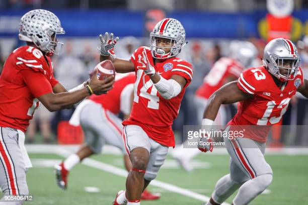 Ohio State Buckeyes wide receiver KJ Hill fakes the handoff from quarterback JT Barrett during the Cotton Bowl Classic matchup between the USC...