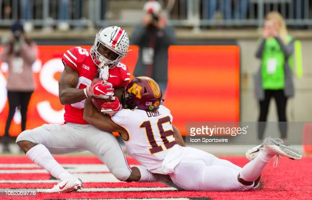 Ohio State Buckeyes wide receiver Terry McLaurin catches a ball for a touchdown as Minnesota Golden Gophers defensive back Coney Durr defends in a...